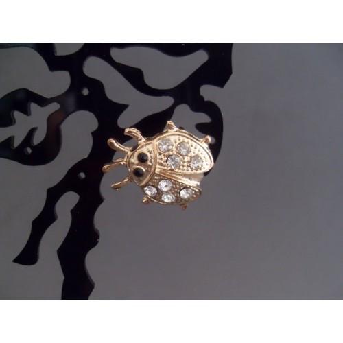 Brosa bijuterie aurie cu cristale